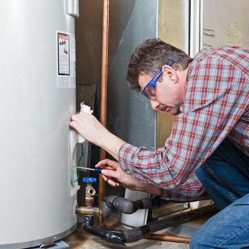 A Technician Inspects a Water Heater.