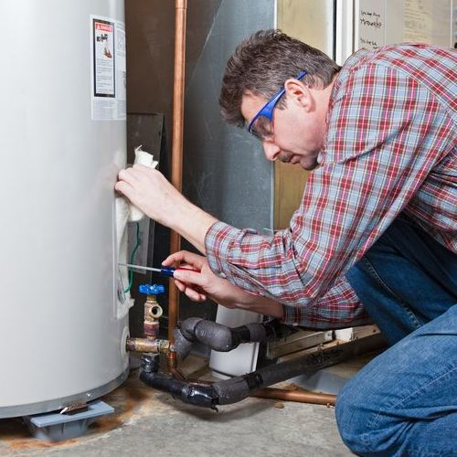 A Technician Services a Water Heater