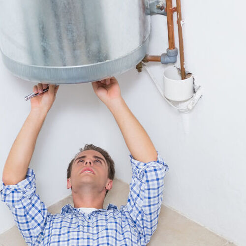 A Technician Installs a Water Heater.