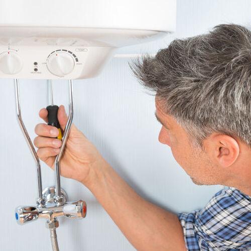 A Technician Checks Water Heater.