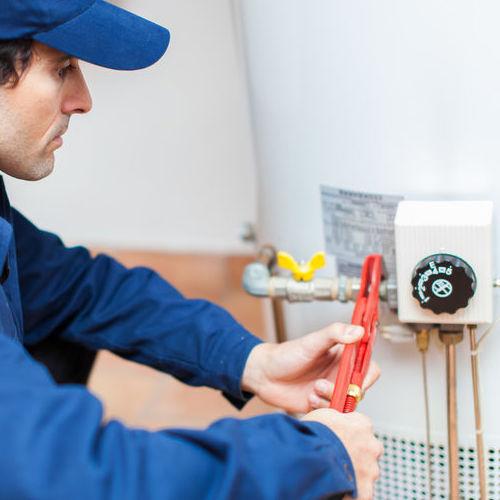 A Technician Checks a Water Heater.