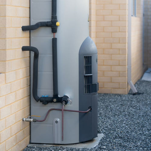 A New Gas Water Heater Installed Outside a Home.